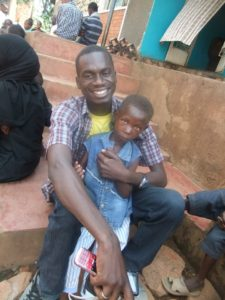 Innocent with child in Gulu, Uganda